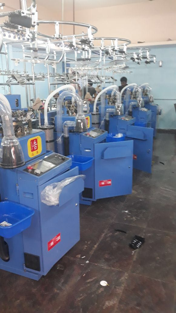 Fully automatic glove machine features